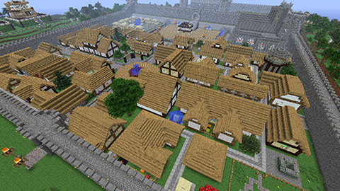 Minecraft city created builded Minecraft's project - Minecraft village town city with castle included and surrounded by big cobblestone, stone wall - alaborated Minecraft project, propably created by few players
